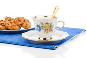 Chocolate Chip Cookies And Cup Of Tea On White Background