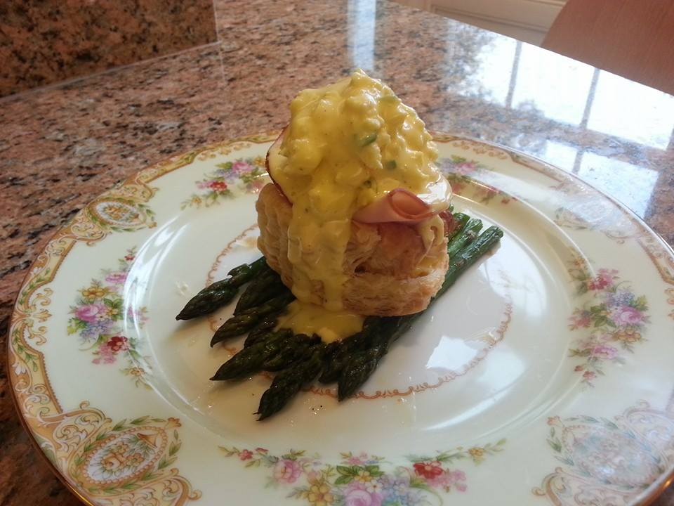 Belle Grove Plantation Eggs Benedict withCream Cheese Scrambled Eggs and Virignia Ham in Puff Pastry on Roasted Asparagus with Fresh Hollandaise Sauce at Belle Grove Plantation Bed and Breakfast